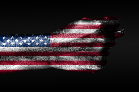 A hand with a painted USA flag shows a barreling on a dark background. Vertical frame