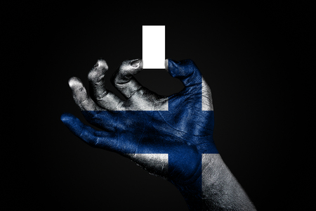 hand with a painted flag Finland holding a small white sheet with space for an inscription, mock up. Horizontal frame