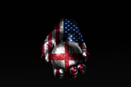 A hand with a drawn USA flag holds a ball with a drawn England flag, a sign of influence, pressure or conservation and protection. Horizontal frame