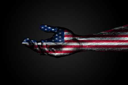Outstretched hand with a drawn USA flag, a sign of help or a request, on a dark background. Horizontal frame