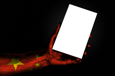 hand with painted flag China holding a large white sheet with space for an inscription, mock up. Horizontal frame