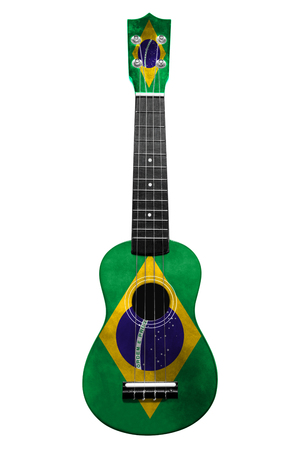 Hawaiian national guitar, ukulele, with a painted Brazil flag, on a white isolated background, as a symbol of folk art or a national song. Vertical frame