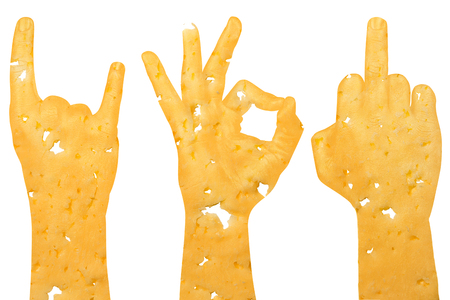 a set of three hands cut from cheese shows a middle finger, a goat and okay, a sign of aggression, protest and approval on a white background. Horizontal frame