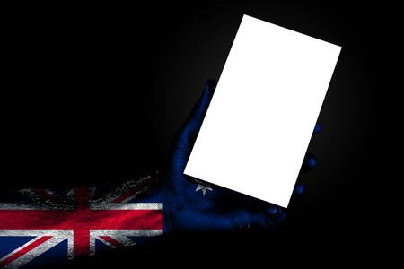 hand with painted flag Australia holding a large white sheet with space for an inscription, mock up. Horizontal frame