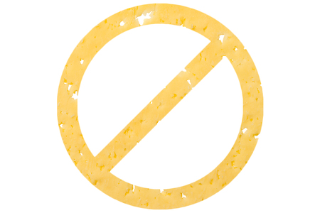Symbol ban cut out of cheese, as a sign of dangerous food, sanctions on a white isolated background. Horizontal frame Stockfoto