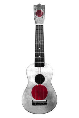 Hawaiian national guitar, ukulele, with a painted Japan flag, on a white isolated background, as a symbol of folk art or a national song. Vertical frame