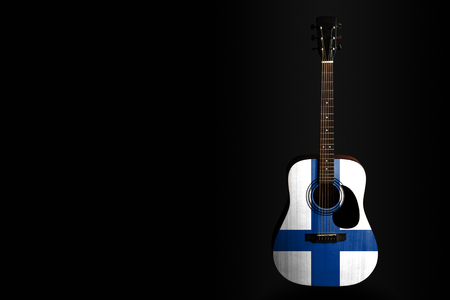 Acoustic concert guitar with a drawn flag Finland, on a dark background, as a symbol of national creativity or folk song. Horizontal frame