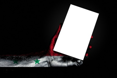 hand with painted flag Syria holding a large white sheet with space for an inscription, mock up. Horizontal frame