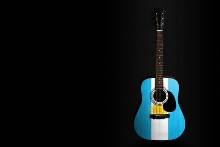 Acoustic concert guitar with a drawn flag Argentina, on a dark background, as a symbol of national creativity or folk song. Horizontal frame