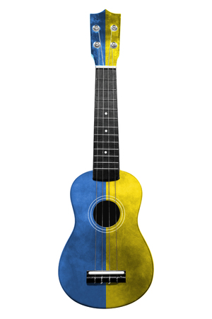 Hawaiian national guitar, ukulele, with a painted Ukraine flag, on a white isolated background, as a symbol of folk art or a national song. Vertical frame Stockfoto
