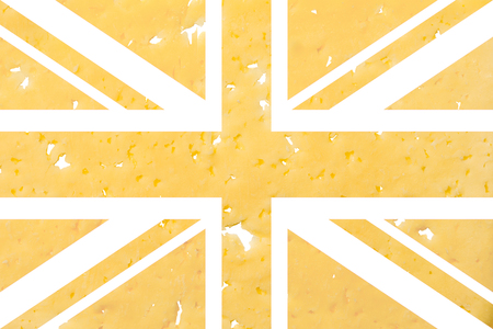 UK flag cut out of cheese, as a symbol of the import or export of cheese on a white isolated background. Horizontal frame