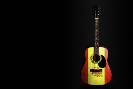 Acoustic concert guitar with a drawn flag Spain, on a dark background, as a symbol of national creativity or folk song. Horizontal frame Stockfoto