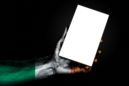 hand with painted flag Ireland holding a large white sheet with space for an inscription, mock up. Horizontal frame