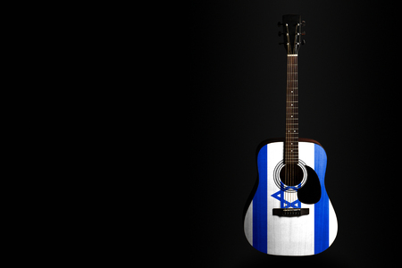 Acoustic concert guitar with a drawn flag Israel, on a dark background, as a symbol of national creativity or folk song. Horizontal frame