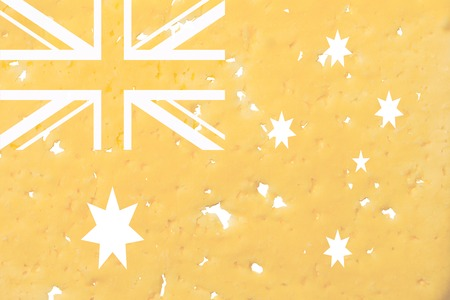 Australia flag cut out of cheese, as a symbol of the import or export of cheese on a white isolated background. Horizontal frame Stockfoto