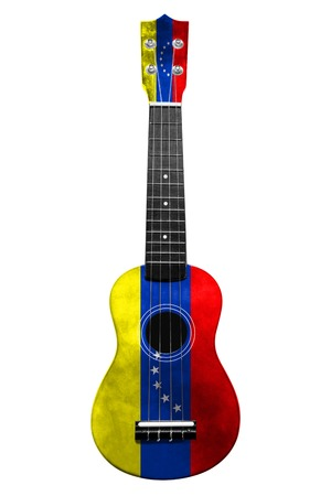 Hawaiian national guitar, ukulele, with a painted Venezuela flag, on a white isolated background, as a symbol of folk art or a national song. Vertical frame Stockfoto