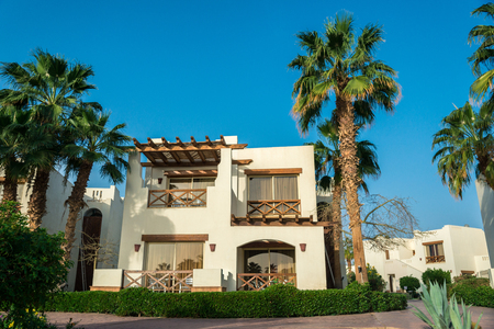 Sharm el-Sheikh, Egypt, 02252019. The interior of the hotel, two-story houses among the palm trees. Horizontal frame Redactioneel