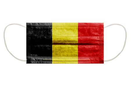 Virus mask with flag of belgium on an isolated white background. Symbol of protection against coronavirus infection. Horizontal frame Foto de archivo