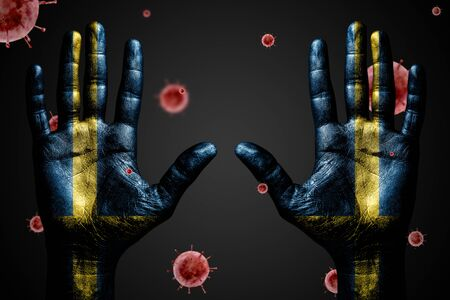 Danger concept from coronavirus, arms up with Sweden flag and flying bacteria Covid-19, on dark isolated background.
