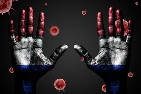 Danger concept from coronavirus, arms up with France flag and flying bacteria Covid-19, on dark isolated background.