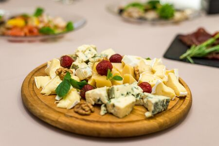 Dairy products, assorted different types of cheeses on a dish.