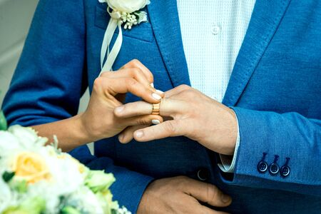 the main point of the ceremony of painting the newlyweds, dressing the ring.