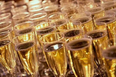 many glasses of champagne for the whole frame.