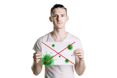 young man holds a picture of bacteria. The danger of coronavirus