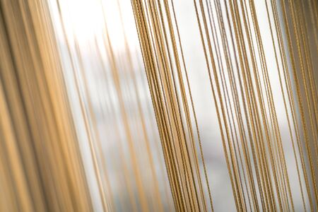 Abstract background from vertical lines in beige color.