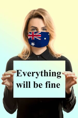 Girl with blond hair in a mask with the flag of Australia and a sheet with the inscription