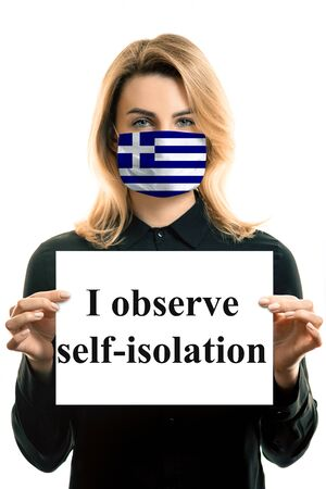 Girl with blond hair in a mask with the flag of Greece and a sheet with the inscription