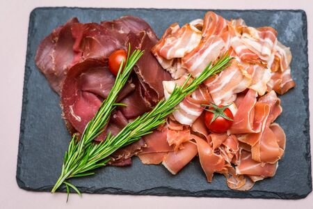 assorted cold cuts with herbs on a plate. 免版税图像 - 147635306