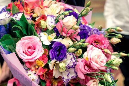 beautiful bright wedding bouquet lies on the grass. horizontal frame 免版税图像