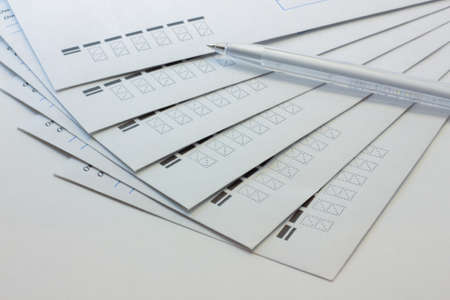 white envelopes and a pen