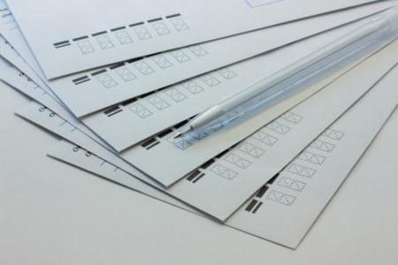 white envelopes and a pen-2 Stock Photo