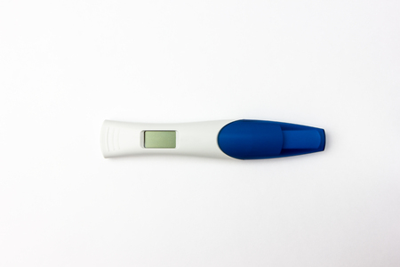 Pregnancy test on a white background. Electronic pregnancy test close-up on a white background. 版權商用圖片