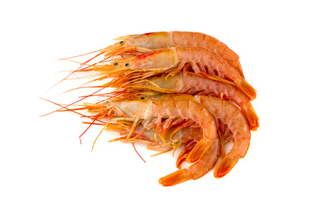 Raw prawns on a white background. Shrimp langoustina close-up on a white surface.