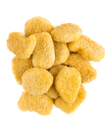 Frozen nuggets on a white background. Several chicken nuggets in breading close-up on a white background.
