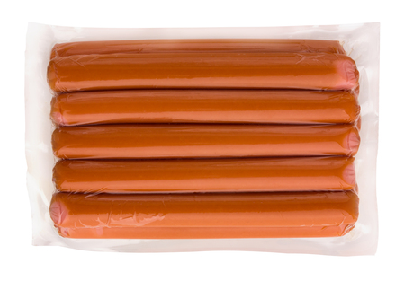 Sausages in vacuum packaging on a white background. A pack of sausages from a store isolated on a white background.