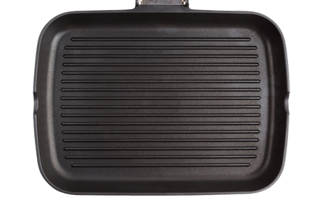 Grill pan isolated on white background. New grill pan closeup on a white background. Stock Photo