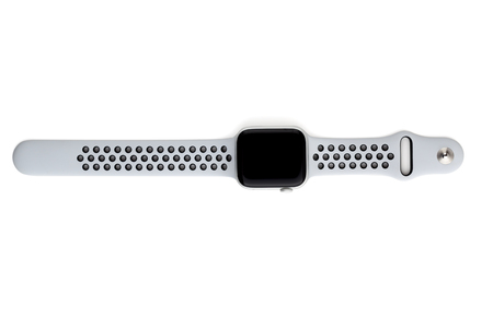 Rostov-on-Don, Russia - December 2018. Apple Watch Nike + Silver Aluminum Case with Pure Platinum on a white background. New watches from the company APPLE close up on a white background. Editorial