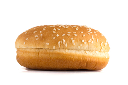 Burger bun on a white background. Bun cut in half close up on a white background. Reklamní fotografie