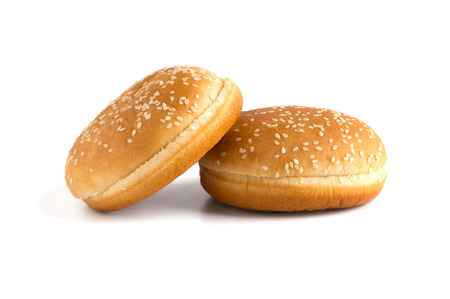 Burger buns on white background. Two buns cut in half close up on a white background. Reklamní fotografie