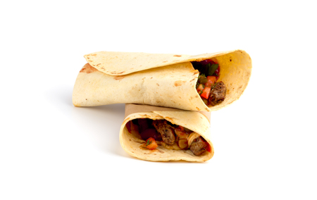 Shawarma on a white background. The Doner kebab close up on a white background.