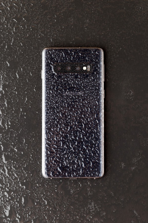 Rostov-on-Don, Russia - March 2019. Samsung Galaxy S10 on a wooden surface.The new Samsung smartphone on the surface of the slate. Editorial