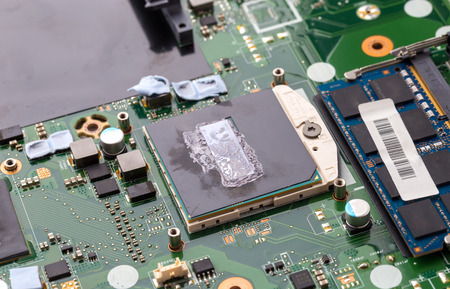 Thermal paste on the processor. Old thermal grease on the processor close-up.