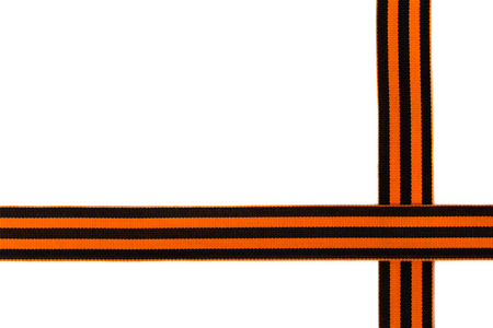 St. George ribbon on a white background. Black orange ribbon close up on a white background.