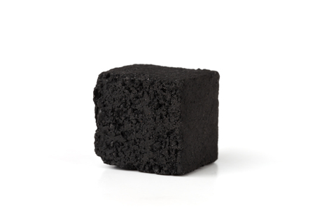 Coconut charcoal on a white background. Coconut coal cubes for hookah close-up.