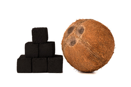 Coconut charcoal on a white background. Coconut coal cubes for hookah and coconut close-up.