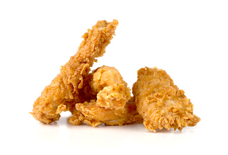 Fried chicken fillets on a white background. Fried chicken nuggets close-up.